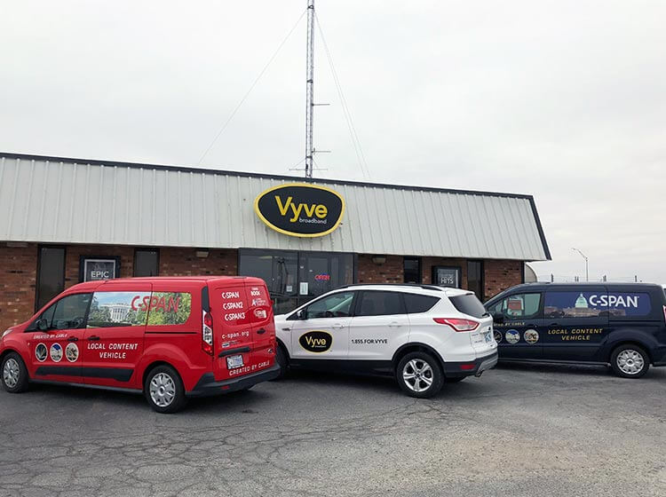 CSPAN and Vyve vans parked outside Shawnee Headquarters
