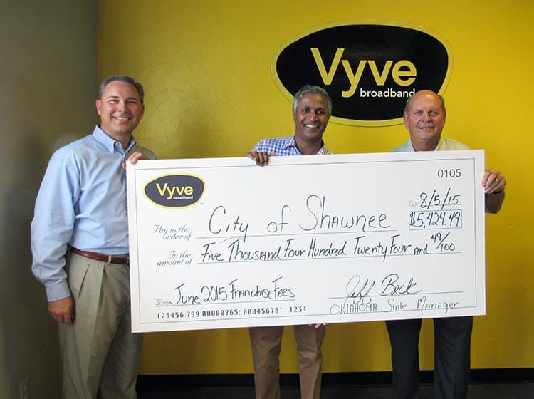 Vyve employees present a check to the City of Shawnee