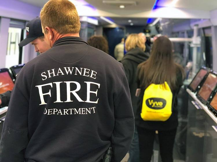 A member of the Shawnee Fire Department attends a Vyve event