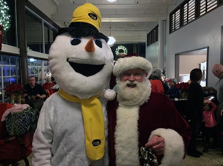 Vyve snowman poses with Santa