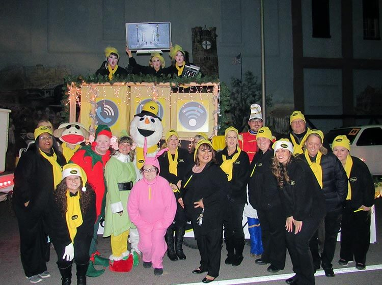 Vyve employees pose for a picture during the Shawnee Christmas Parade